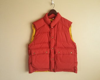 c38910608dfdf Vintage Eddie Bauer Red   Yellow Down Puffer Vest. Marty McFly. Back To The  Future. Button Front. Big Front Pockets. 100% Nylon. Insulated.