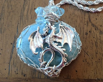 Amazonite light turquoise stone embellished with silver wire, crystal beads and a silver colored dragon.