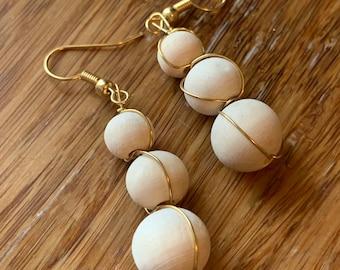 Gold dangle wood bead earrings