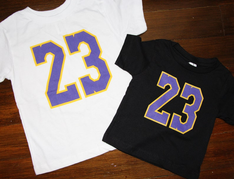 pretty nice a7fba 481d2 23 in purple and gold Unisex Children's T-Shirt - Lebron James Lakers  T-Shirt Jersey