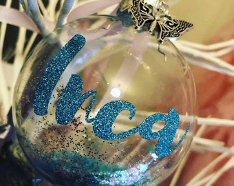 Personalised Blue Glass Bauble Embellished with a Silver Butterfly and Blue Confetti