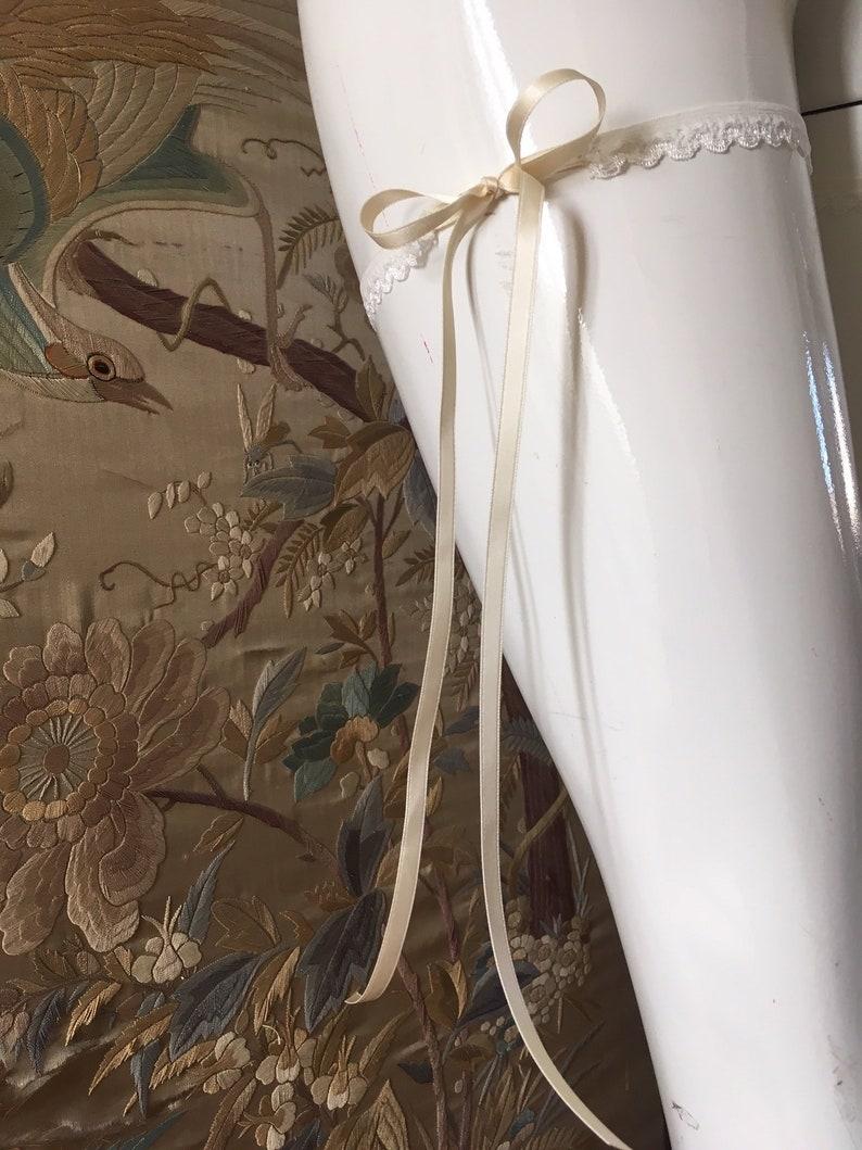 Beautiful elegant wedding garter with long ribbons