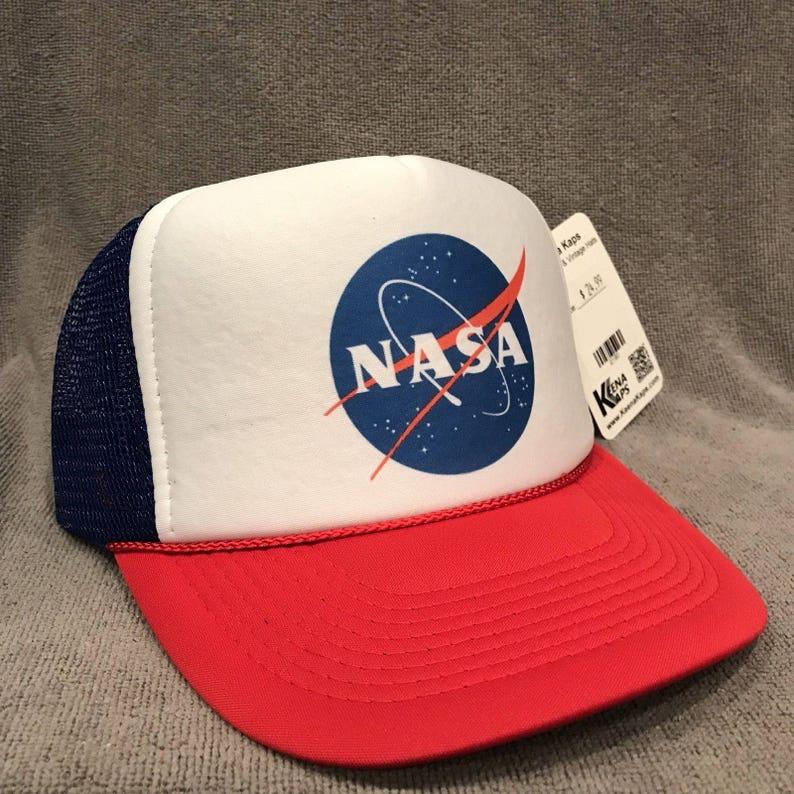 0d9596210cc NASA Trucker Hat USA Space Program Old Logo Vintage Snapback