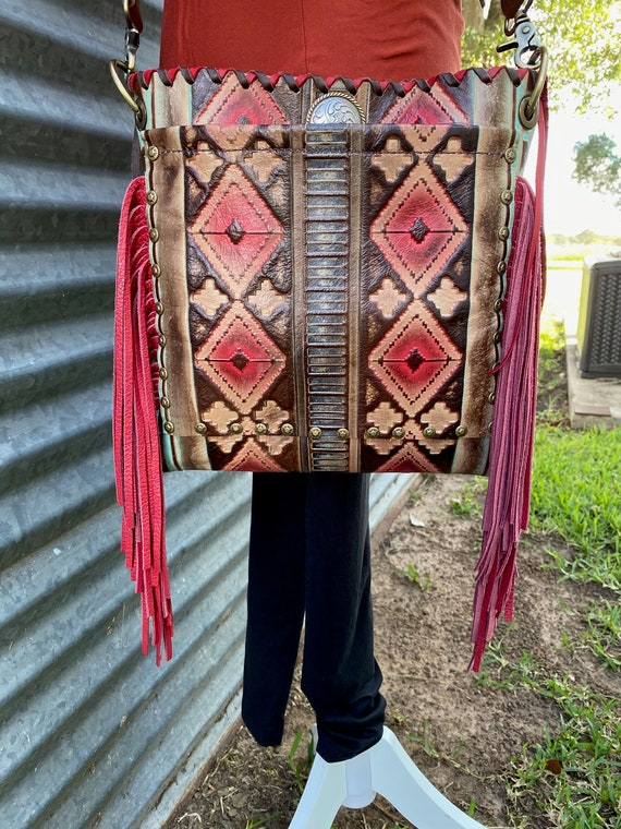 Handmade Navajo pattern leather crossbody in reds and browns with lots of FRINGE!! Made in Bellville, TEXAS USA