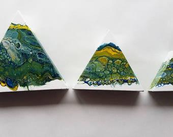 Triad of Triangles