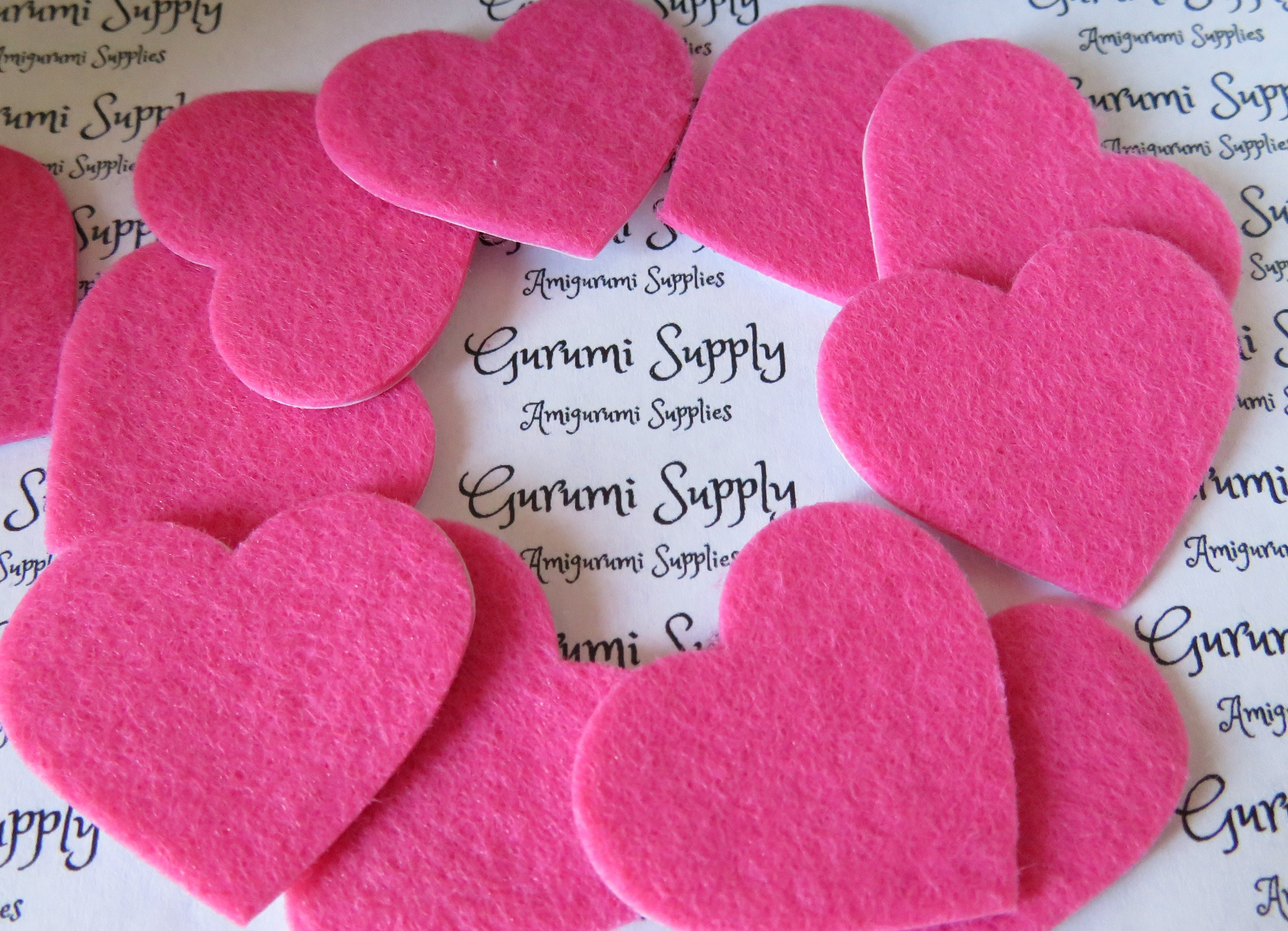 1 4 inch Pink Heart shape felt cut-outs with a sticker