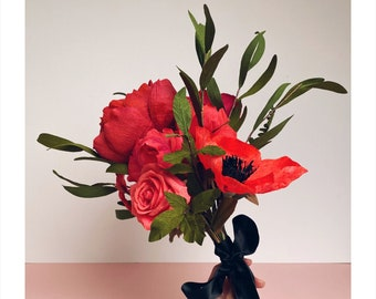 Red paper flowers bouquet for a wedding or anniversary.