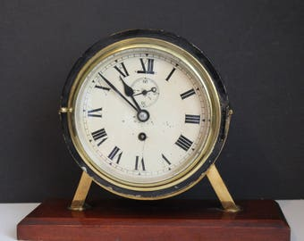 An Early C20th Brass & Metal Bulkhead Wall Clock on Mantle Plinth
