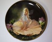 Danbury Mint Collectors plate. Flower Child from the The Enchanted Garden Collection.