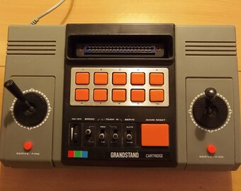 Grandstand SD-050 video game console with 2 game cartridges