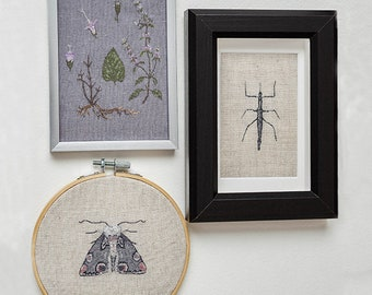 Three handmade embroideries. Mint branch, beetle stick and moth.