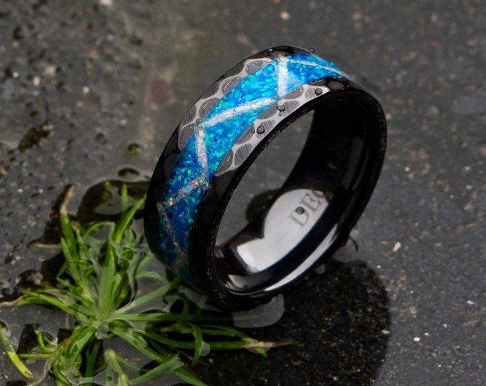 Black Ceramic ring with bright blue opal and white fire opal. galaxy opal