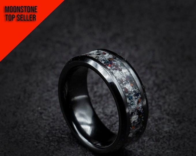 Black ceramic ring with crushed opal.