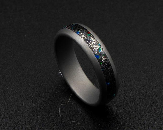 mens meteorite wedding band, galaxy opal ring, red opal, green opal, sandblasted tungsten ring, gunmetal ring, Muonuonalusta meteorite dust.