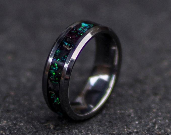 Galaxy opal tungsten ring with glowstone.
