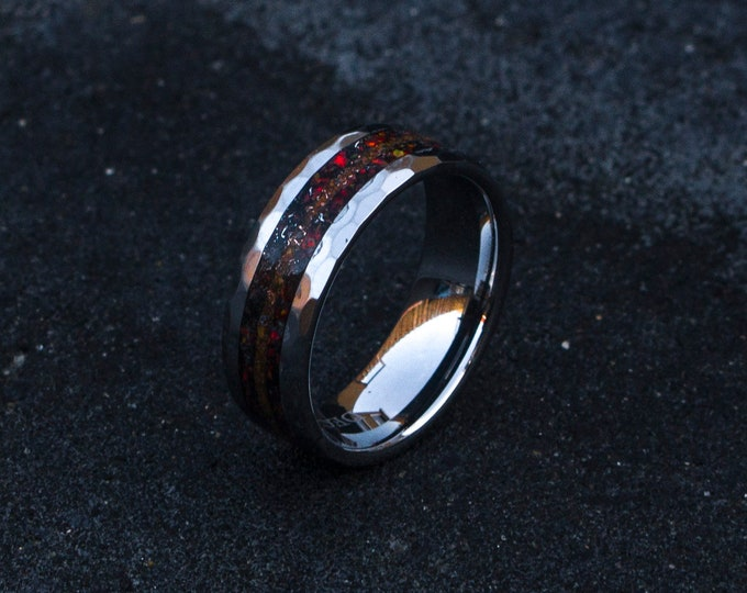 Black opal ring with tiger eye and meteorite dust.