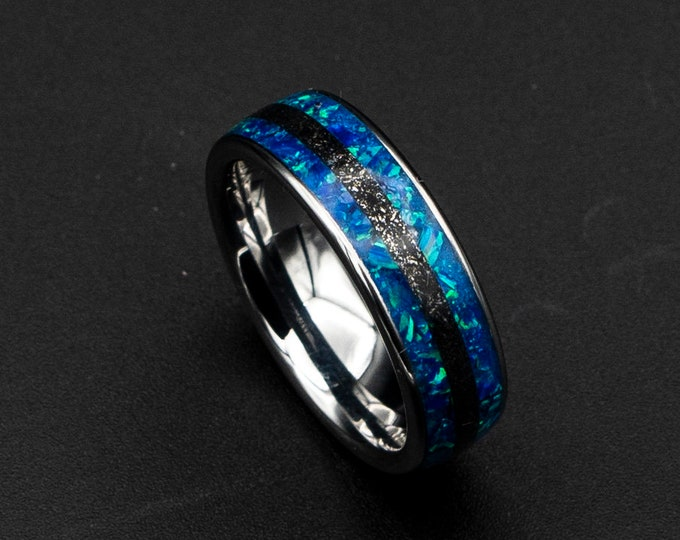 Blue opal ring with meteorite inlay.