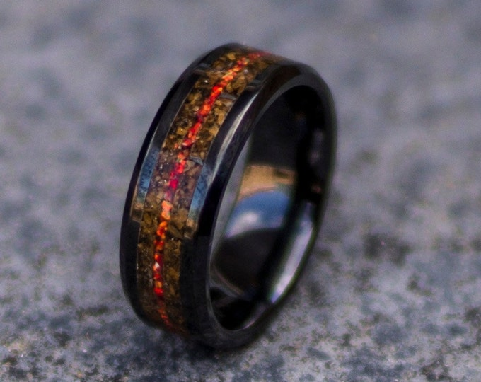 Black ceramic ring with tiger eye and red fire opal.