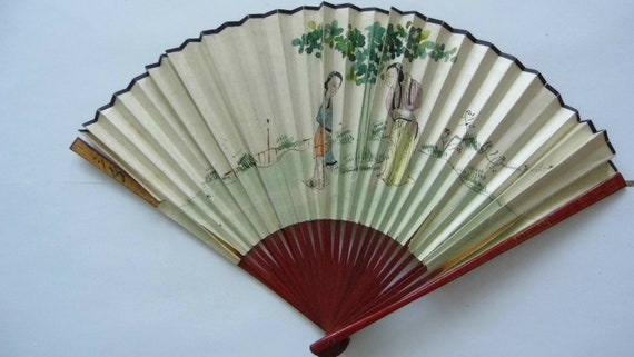 Japanese fan. Early 20th. Double-sided decorations