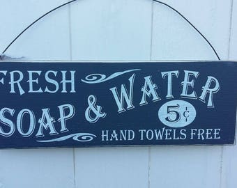 Fresh soap and water wooden sign.