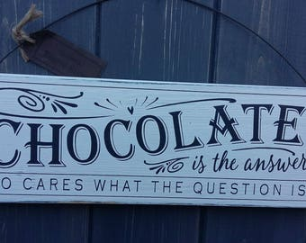 Chocolate is the answer wooden sign.