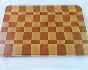 End grain cutting board made from cherry and maple