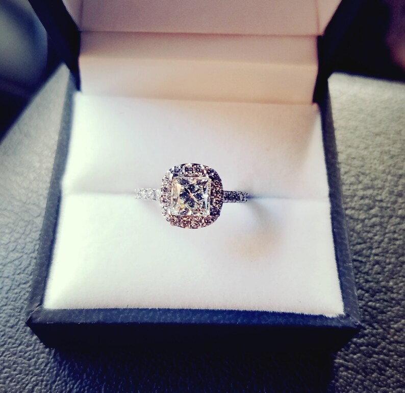 Princess Cut Engagement Ring With A Diamond Cushion Halo And Diamond Band