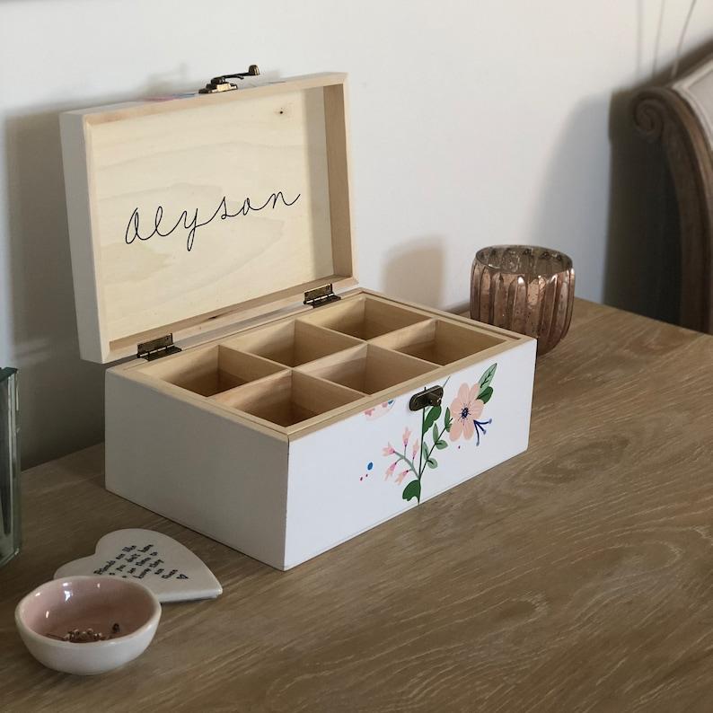Handpainted wooden jewelleryjewelry box with a folk art design.