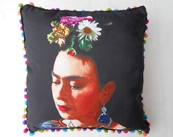 Frida Kahlo cushion on a black background