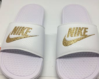 blue nike slides with gold swoosh