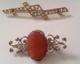 1 deco style and 1 nouveau style brooch