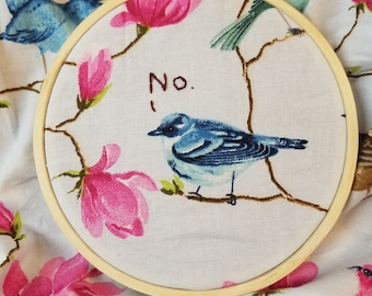 bird completed embroidery, framed in 4 inch hoop