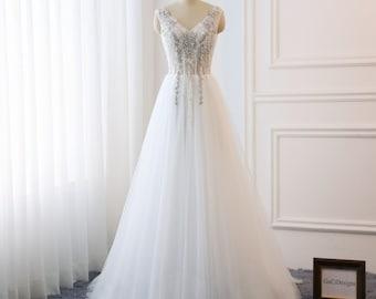 42917861b5c 2018 Beach Wedding Dresses Boho V-neck Bridal Gown A-Line Fairy Wedding  Dress Lace Applique Bride Dress Illusion Back Tulle Dress with Train