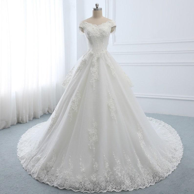 06f44a7064ce 2019 Aline Princess Wedding Dress Unique White Lace Applique | Etsy