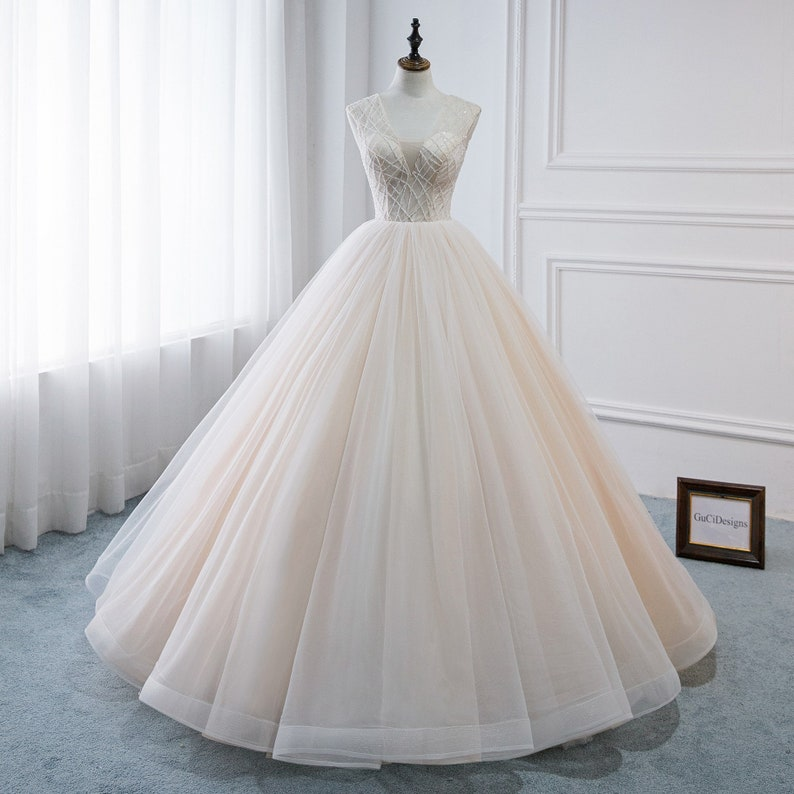 Sweetheart A line Ball Gown plus size wedding dress With Beaded top And Corset Back