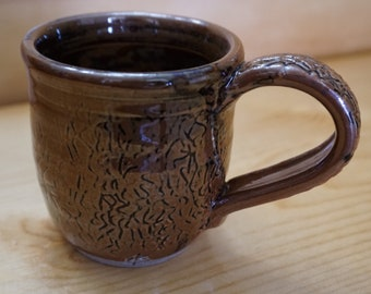 Black and brown cup