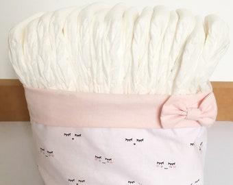 White and pink storage basket