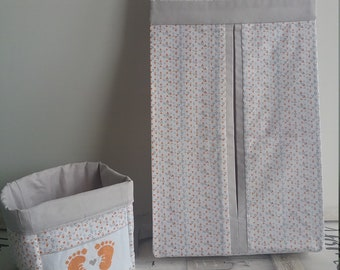 NEW. Storage bag for diapers with cross stitch pattern.