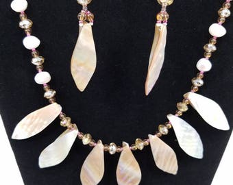 Shell, crystal, and freshwater pearl necklace and matching earrings set