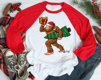 e66ca3d4 Christmas Bigfoot Carrying Xmas Tree Shirt - Sasquatch Bigfoot - Holiday  Ugly Sweater - Kids Funny Shirt - Men Women Kids Tee - Raglan Tee