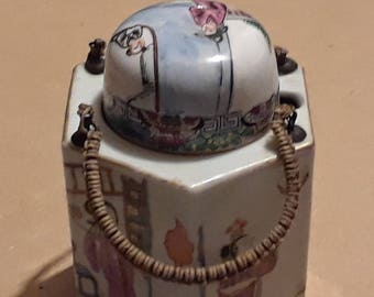Chinese tea pot with added cup porcelain pottery