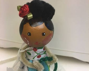 Multi-ethnic clothespin doll