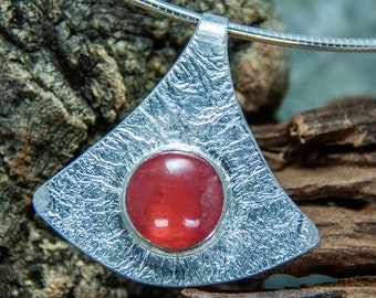 Hand forged silver pendant with rhodochrote