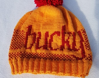 8197bea2895 Buckfast inspired bobble hat. Hand knitted in 100% merino soft wool.  One-size for adults.