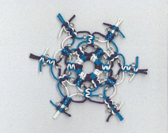 Handmade blue and white macrame snowflake with clear glass beads by TwistedandKnottyUS