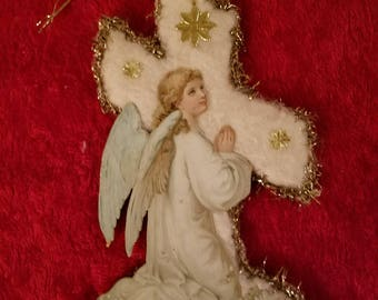 Kneeling Angel Victorian diecut on a Cotton Batting Cross base surrounded by Tinsel Garland and Dresden Stars Decoration