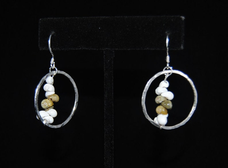 1fd2a86f20493 Sterling silver hoops with white and green pipi shells