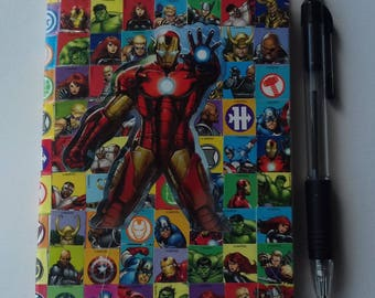 A6 sticker-bombed superhero notebook