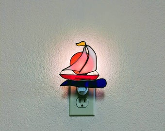 Stained Glass Sailboat against the setting sun Night Light. Free Shipping within the United States.