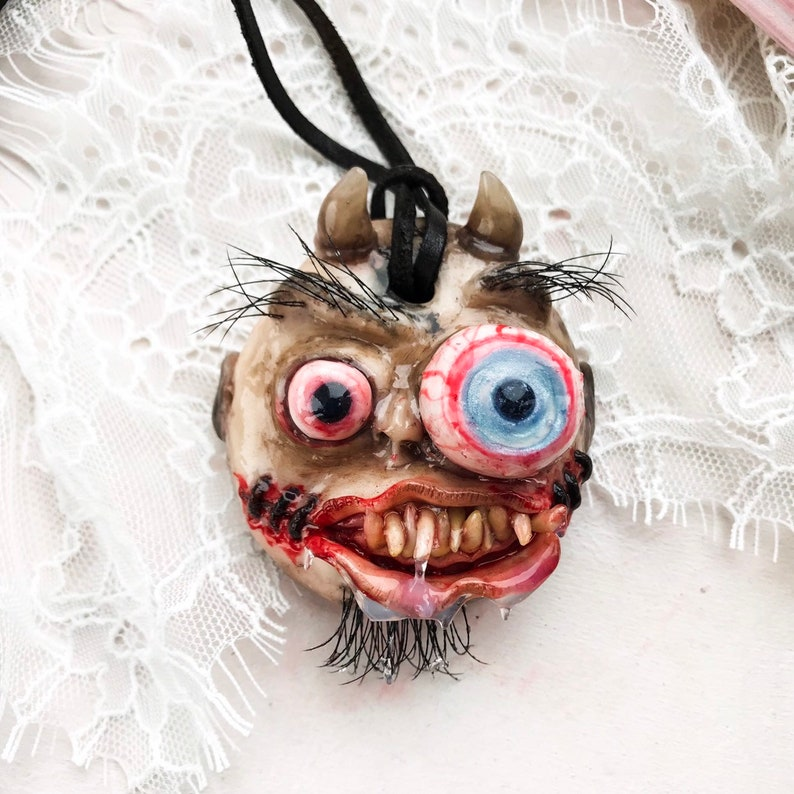 Creepy evil head. Horror pendant head. Ugly dark pendant. image 0